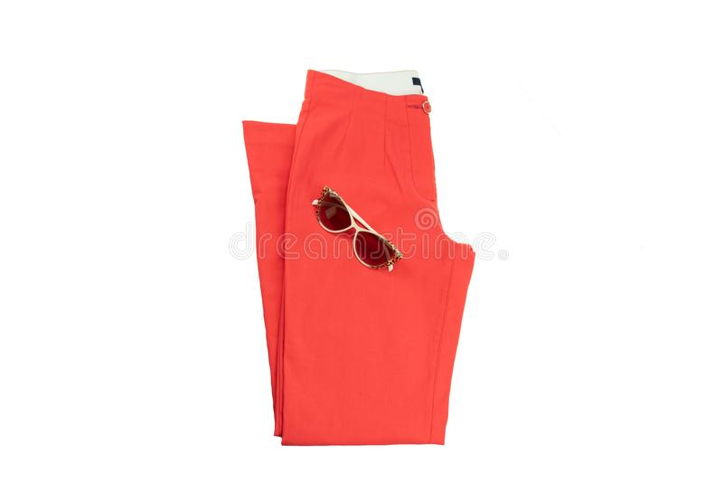 Red elegant woman trousers and a fashionable sunglasses on it. stock image