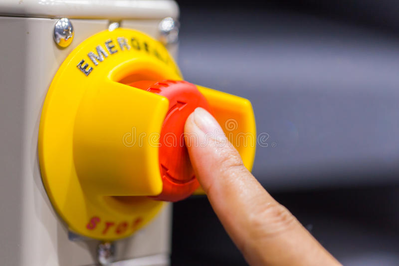 The red emergency button or stop button for Hand press. STOP Button for industrial machine stock photography