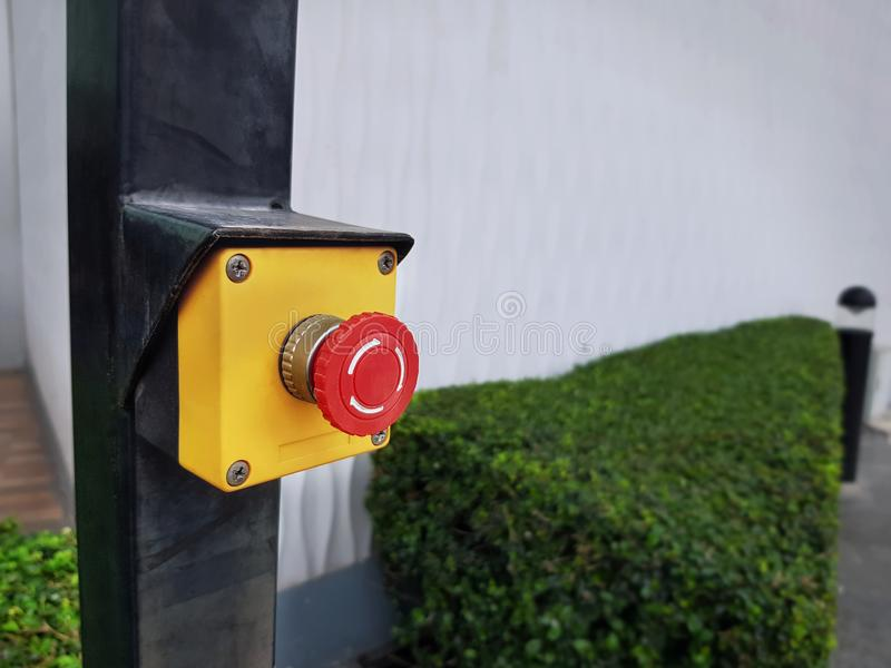 Red Emergency Push Button on Yellow Box stock photo