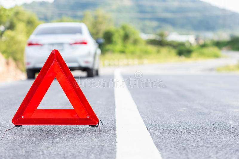 Red emergency stop sign and broken silver car stock photo