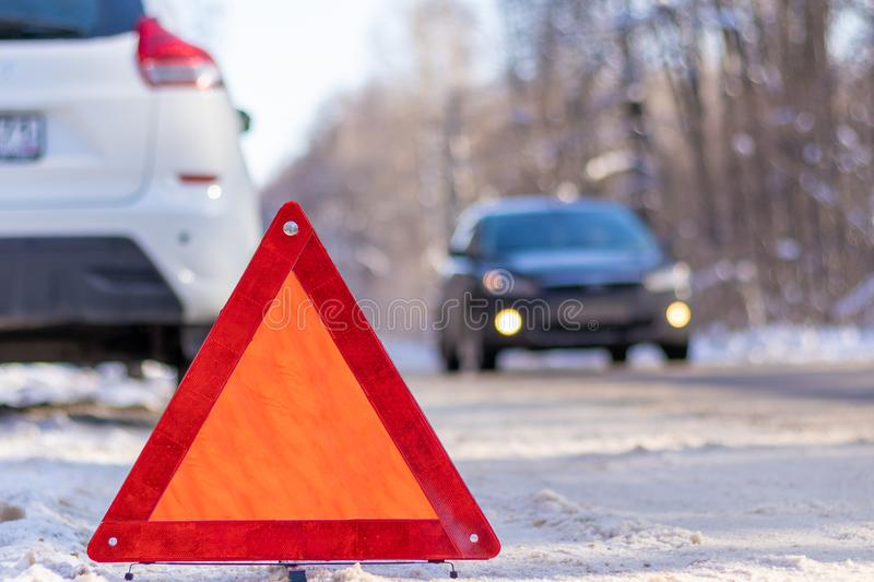The red emergency stop sign is installed on the winter road stock images