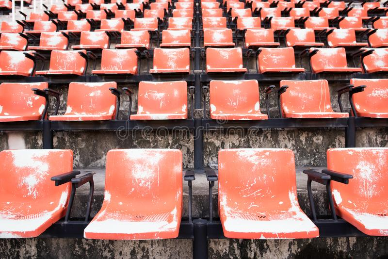 Red Empty and old plastic seats. In the stadium royalty free stock photo