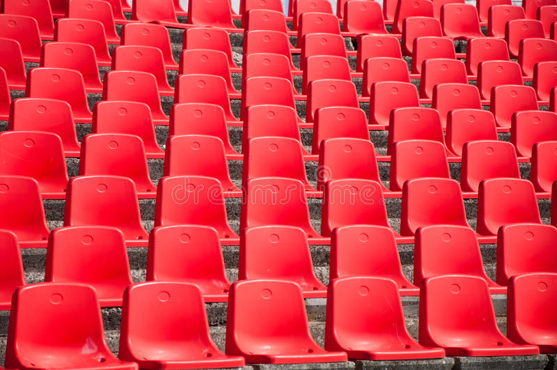 Red empty stadium seats. Rows of red empty stadium seats royalty free stock photography