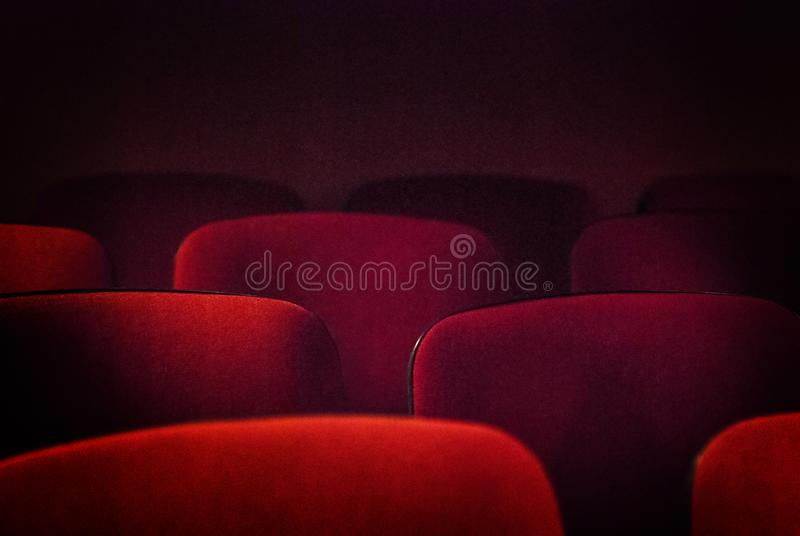 Red Empty Theater Seats. Red old empty theater seats. Shallow DOF stock image