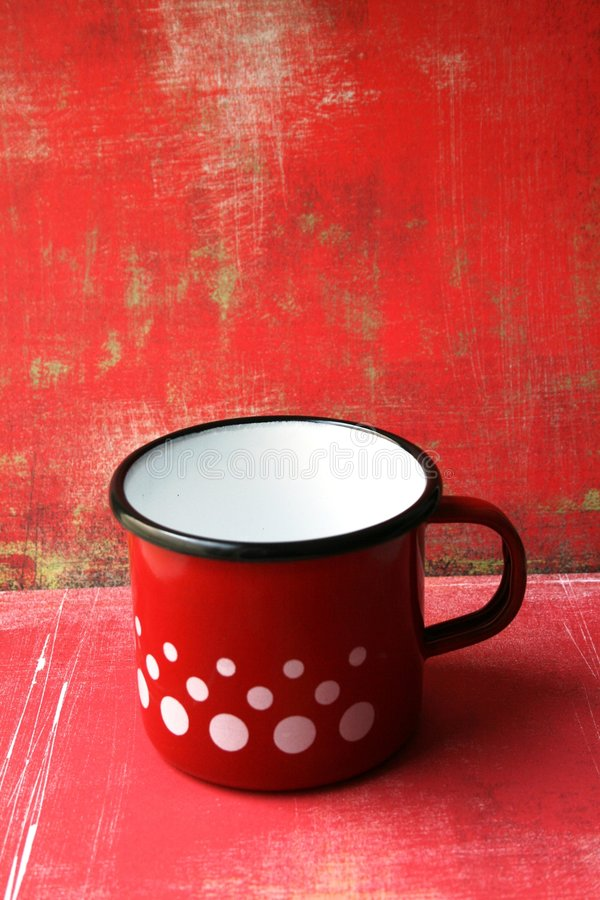 Red enamel cup stock image