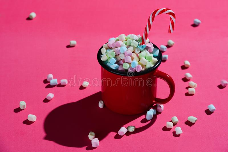 Red enamel mug full of marshmallows royalty free stock photo