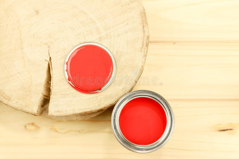 Red enamel paint, wooden background. Flat composition. stock images