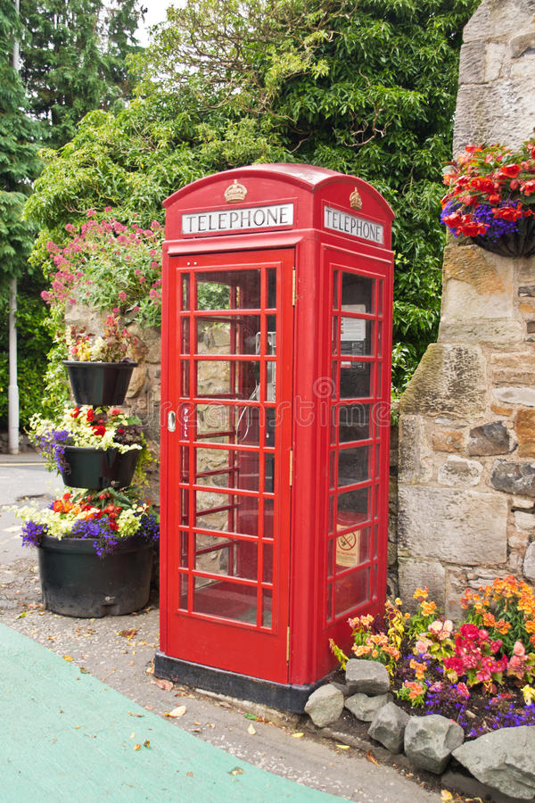 Red English telephone booth. Red old English telephone booth stock photography