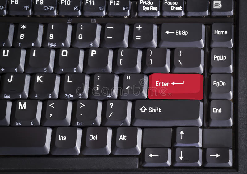 Red enter button computer keyboard. Closeup red enter button of computer keyboard stock photos