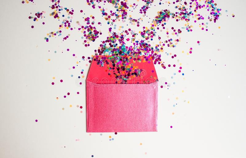 Red envelop on light festive background. With sparkles. Flat lay style stock photos
