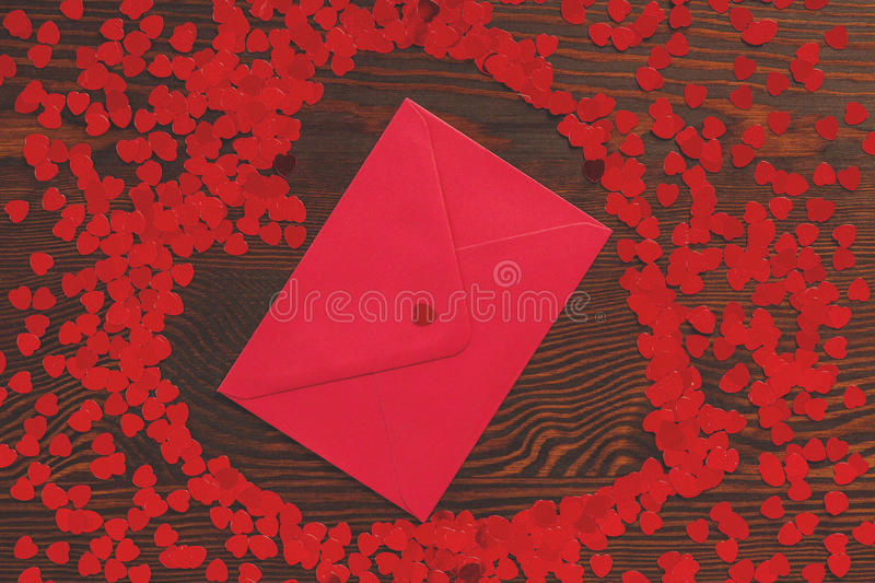 Red envelope with confetti royalty free stock image
