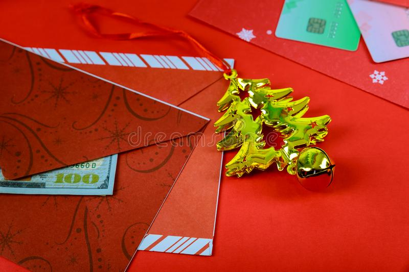 Red envelope with dollar for Chinese New Year bonus in red background,Happy Chinese new year concept stock image