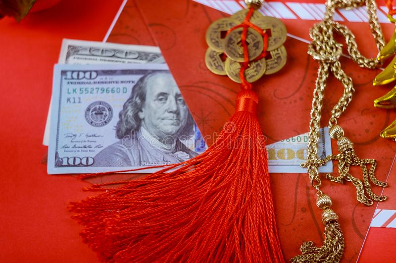 Red envelope with dollar for Chinese New Year bonus in red background,Happy Chinese new year concept royalty free stock photo