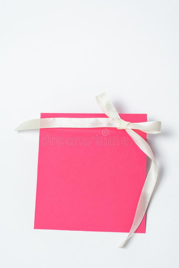 Red envelope with yellow ribbon in the shape of a bow for CD, vertical position . square envelope royalty free stock photos