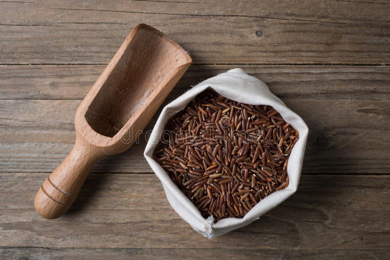 Red ermes rice with bailer. Riso rosso ermes con sassola gluten free sedds royalty free stock photography