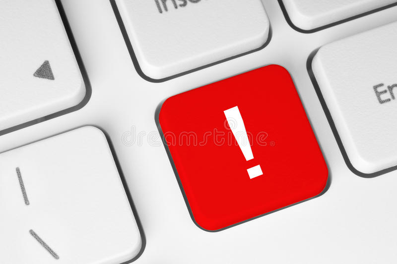 Red exclamation mark button. On the keyboard royalty free stock photos