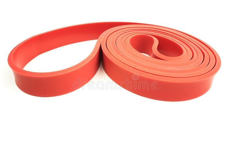 Red exercise resistance band. On a white background with writing space royalty free stock photos