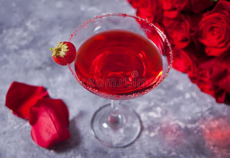 Red exotic alcoholic cocktail in clear glass royalty free stock images