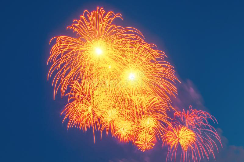 Red explosions of salutes in the sky, with falling sparks stock image