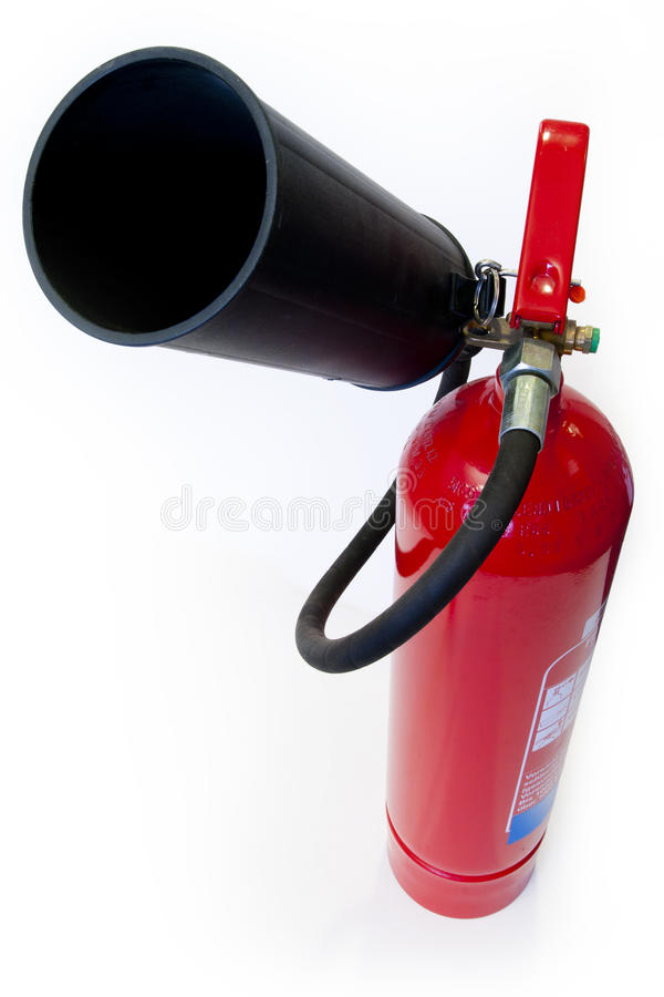 Red extinguisher on white background. A red fire powder extinguisher for fight against small fires in buildings royalty free stock photography