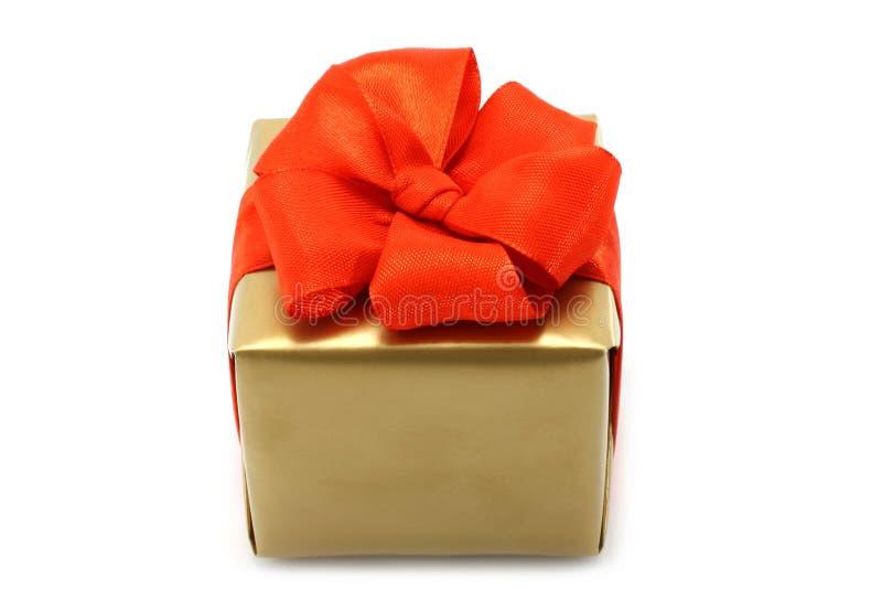 red för present för bowaskguld royaltyfri bild