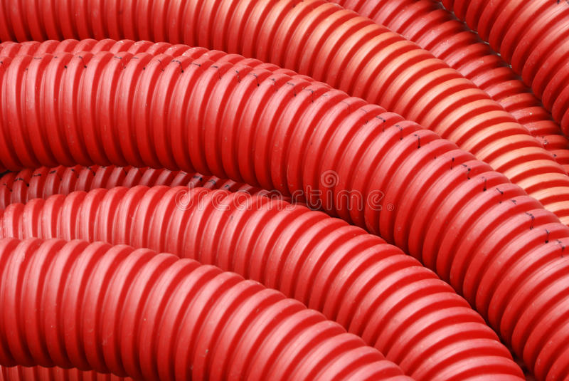 red för rörmokeri för korrugerat rør för coil plastic arkivfoton