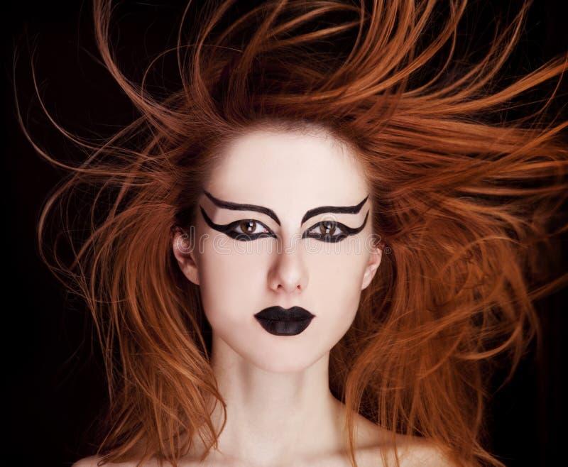 red för stående för closeupkvinnlig haired royaltyfri foto