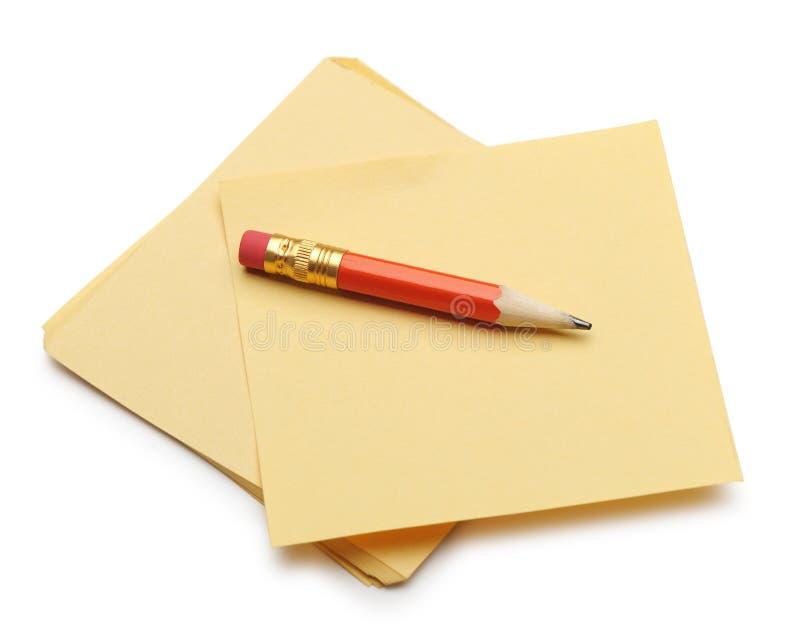 red för blyertspenna för anmärkningspapper arkivbild
