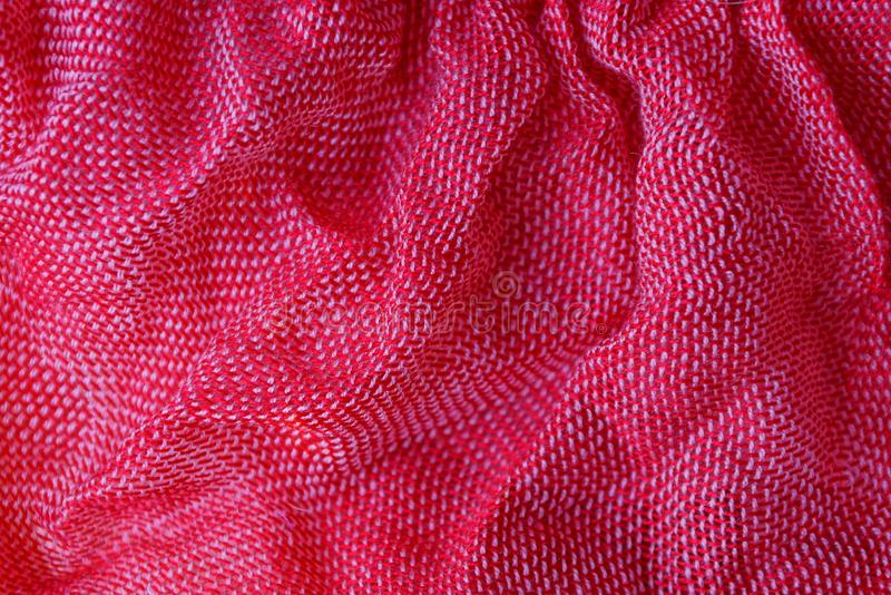 Red fabric texture from a piece of crumpled clothes. Red fabric background from a piece of crumpled clothes stock photography