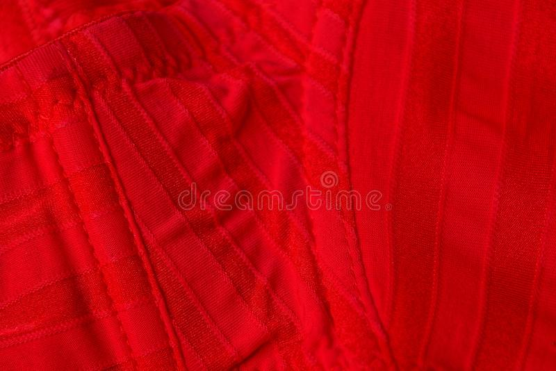 Red fabric texture from a piece of crumpled clothes. Red fabric background from a piece of crumpled clothes stock photos