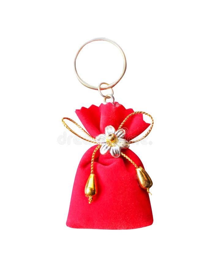 Decoration red fabric bag keychains with flower and gold bow isolated on white background royalty free stock photos