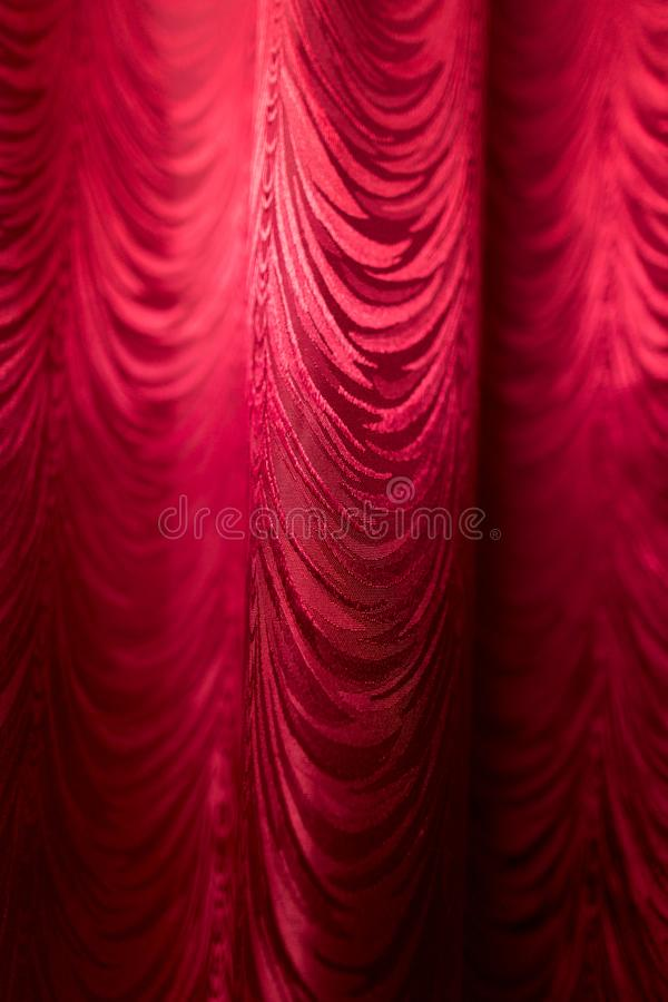 Red fabric curtain as a backdrop. Photo of an abstract texture stock image