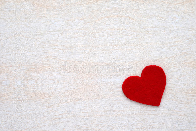 Red fabric heart shape on white wood background, valentine`s day royalty free stock images