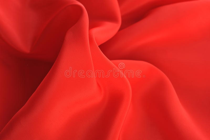 Red fabric ripple background. Close up royalty free stock photos