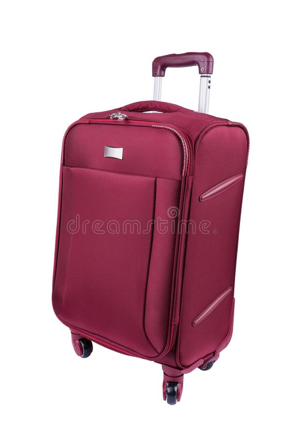 Red fabric suitcase isolated on white background royalty free stock photography
