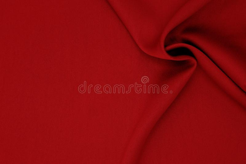 Red fabric texture background with copy space. Perfect as background for fashion blog posts and social media content royalty free stock images