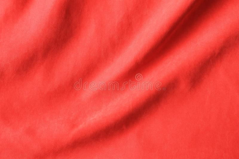 Red fabric texture background, crumpled fabric, top view stock image
