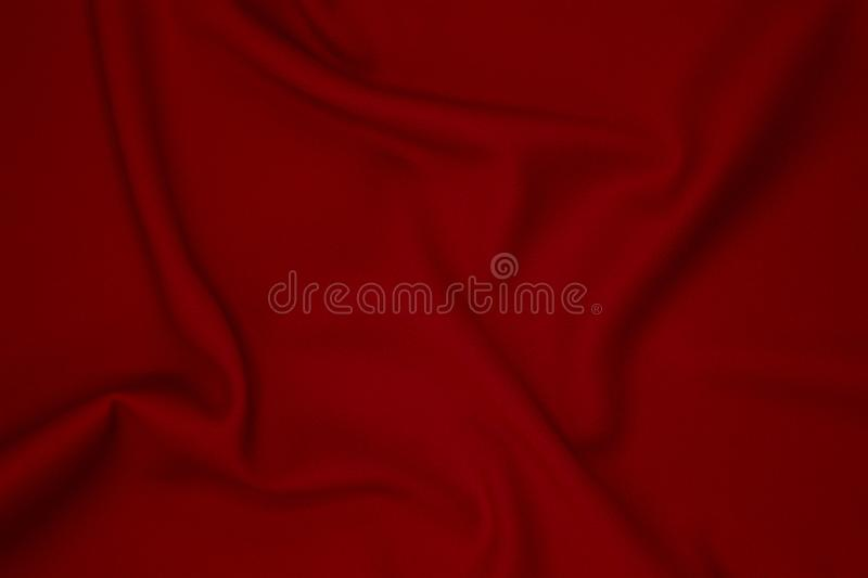 Red fabric texture background. Perfect as background for fashion blog posts and social media content royalty free stock photography