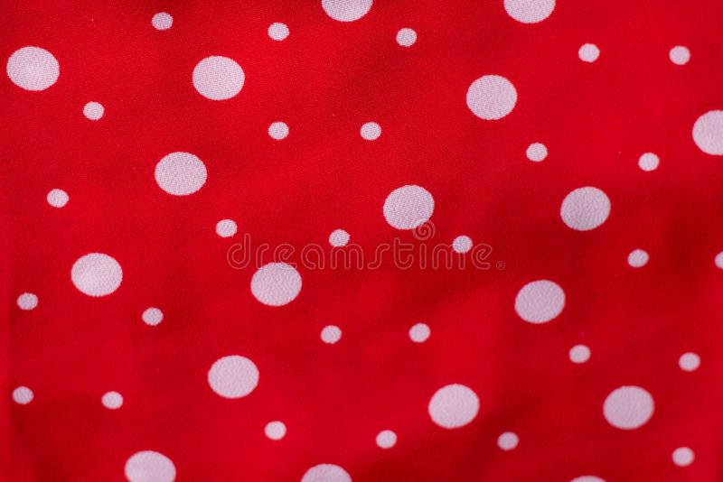 Red fabric texture closeup, useful for background.Polka dot on red canvas cotton texture, fabric background stock images