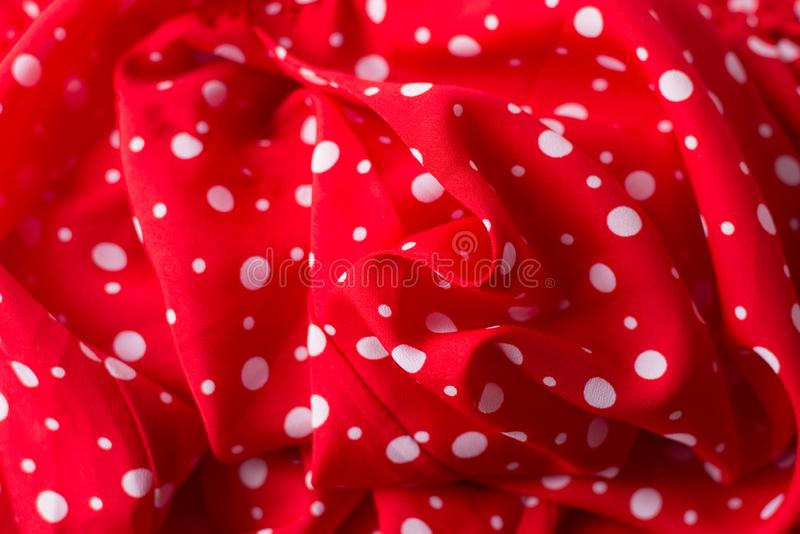 Red fabric texture closeup, useful for background.Polka dot on red canvas cotton texture stock photo