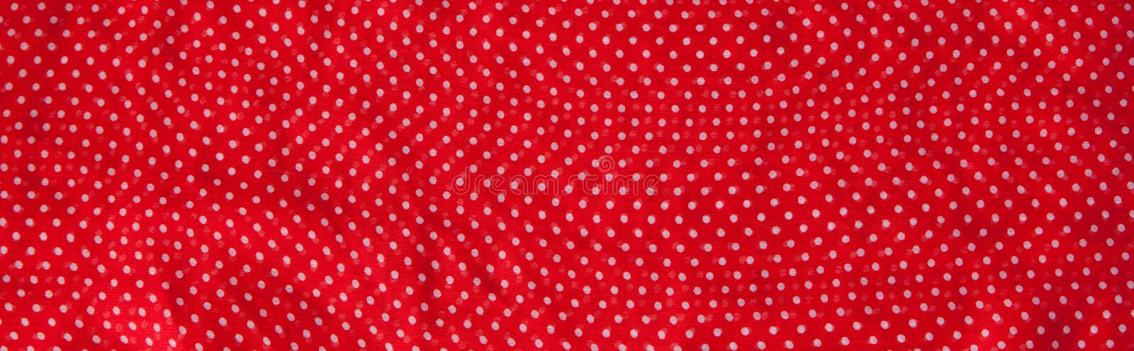 Red fabric with the white polka dots as a background texture composition stock photography
