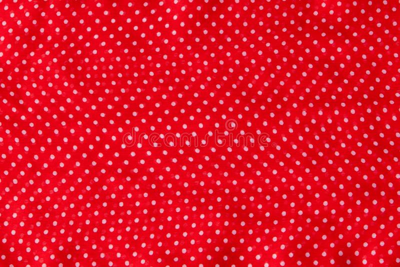 Red fabric with the white polka dots as a background texture composition royalty free stock images