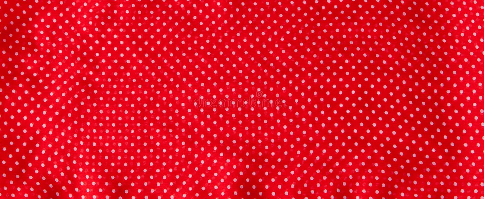 Red fabric with the white polka dots as a background texture composition stock images