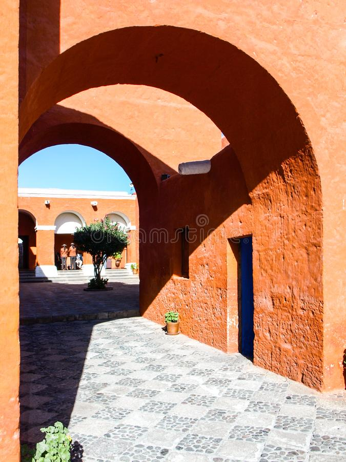 Red facade streets of Santa Catalina Monastery in Arequipa, Peru, South America royalty free stock photo