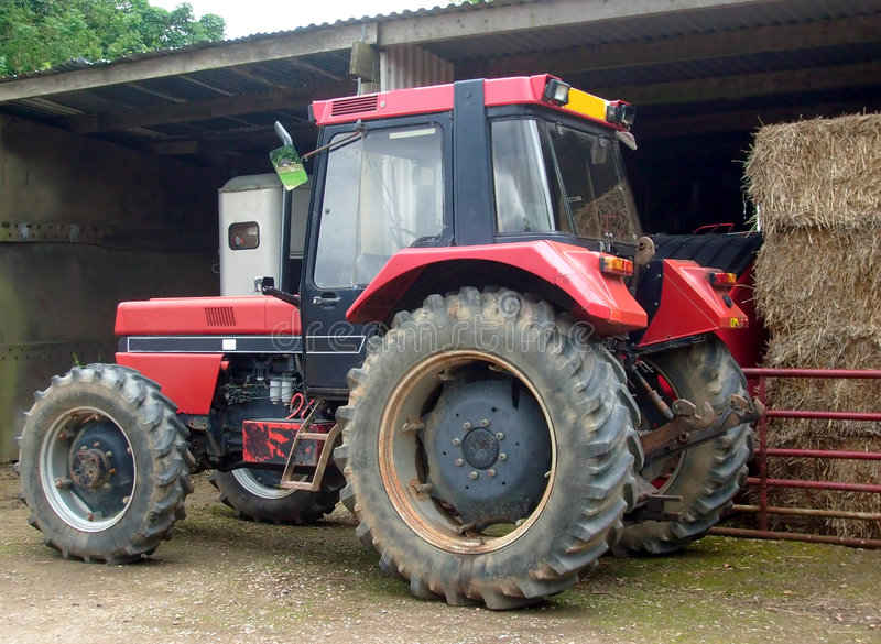 Download Red farm tractor stock photo. Image of bales, close, agricultural - 5748946