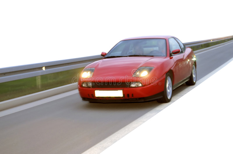 Download Red Fast Racing Car Onthe Highway Stock Photo - Image: 6591000