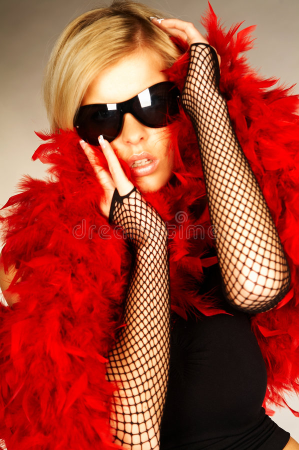 Red feathers #3. Blonde young women wearing black sunglasess and red feathers