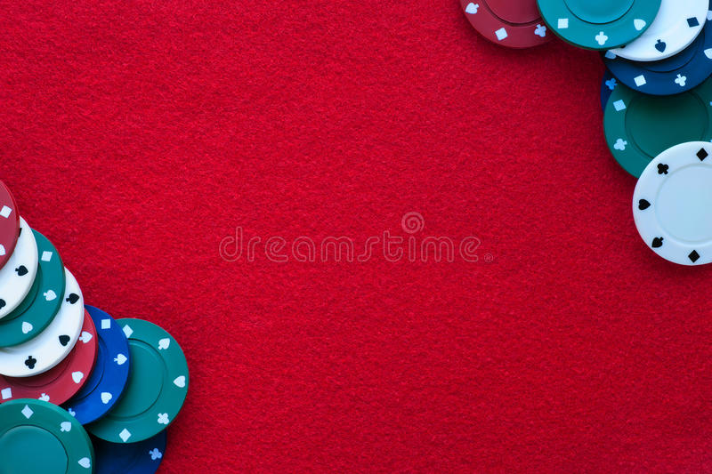 Red felt table with poker chips over it and copy space. Casino, stock photo