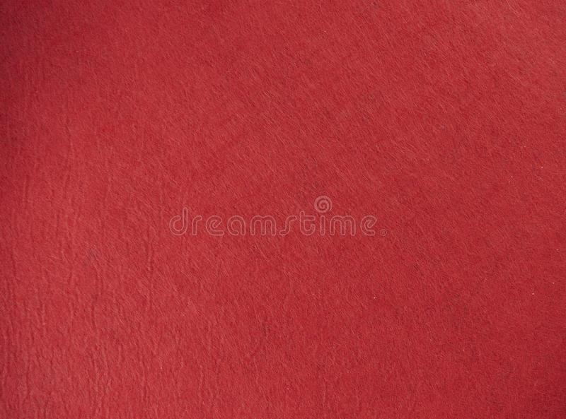Red felt texture background the woven fabric isolated.  royalty free stock photography