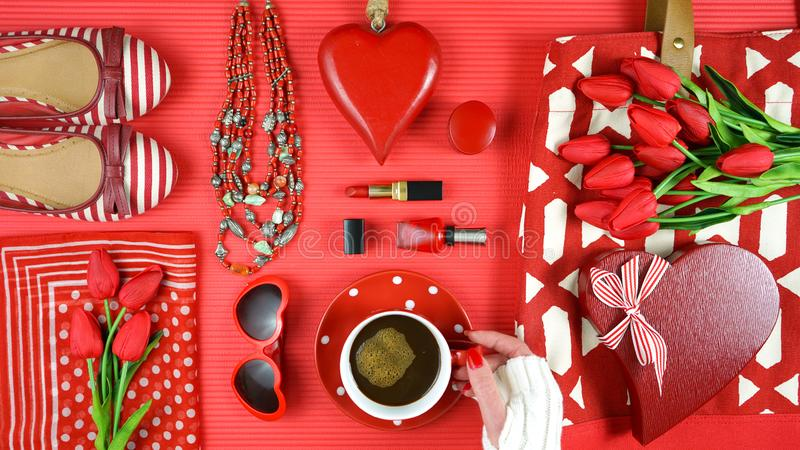 Red feminine accessories travel shopping planning packing concept flatlay. Red feminine accessories travel shopping preparation concept with shoes, bag, scarf stock photos